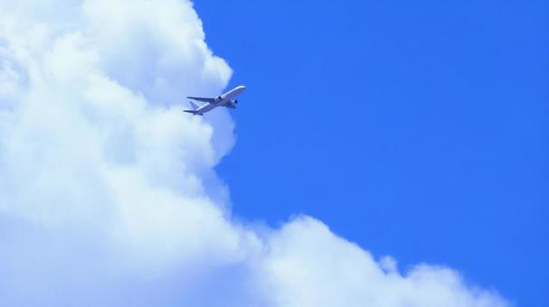 Background material copy space of blue sky and clouds with an airplane flying in the summer sky