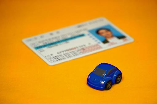 Driver's license blue minicar yellow background