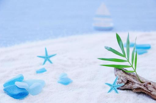 Palm leaves and sandy beach