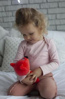 Girl holding a stuffed animal
