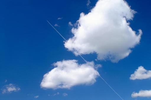 Blue sky and contrails