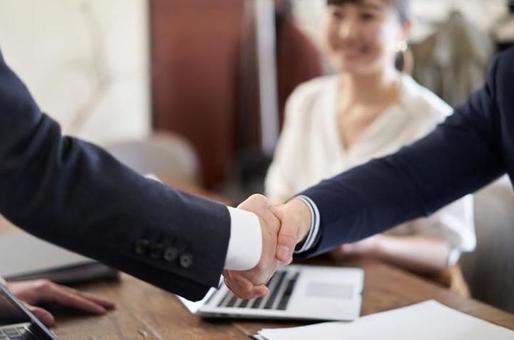 Asian businessman shaking hands