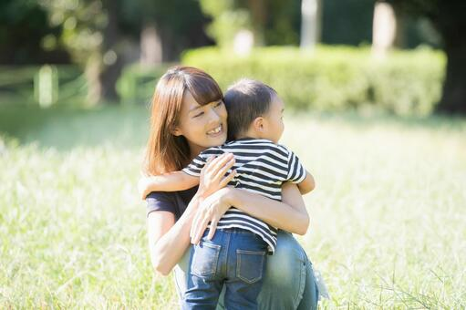 Parent and child in the park (2-year-old child)