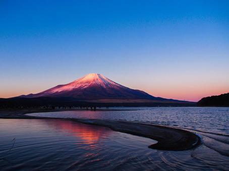 Red Fuji illuminated in red