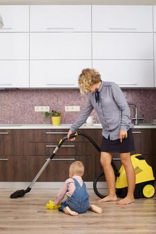 Working mother 4 with a son and a son who imitates a vacuum cleaner