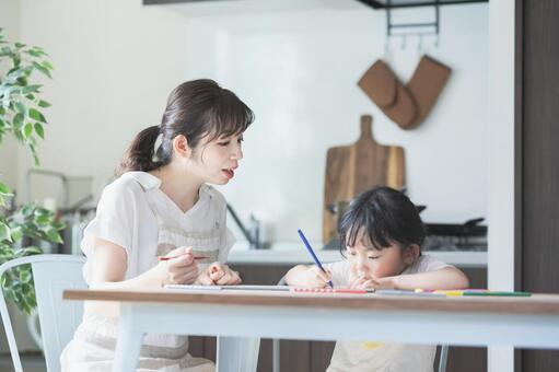 A mother watching over her child's drawing in an apron