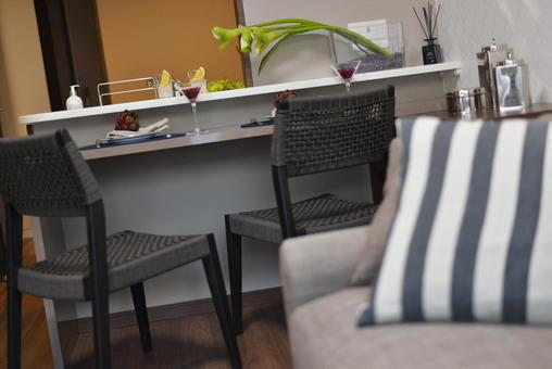Living dining where two adults enjoy an evening drink