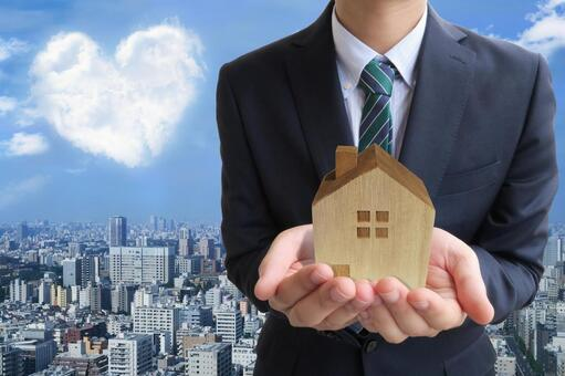 Businessman and heart cloud and house