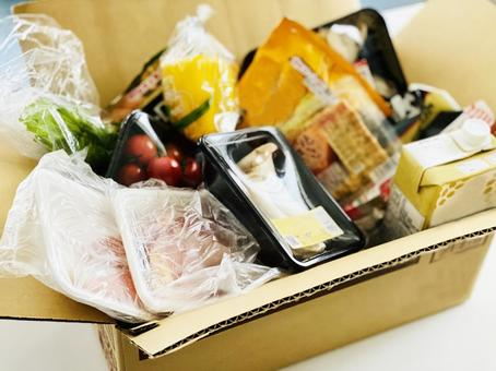 Lots of food in cardboard boxes