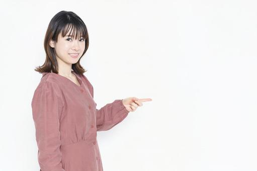 A woman pointing to a business point