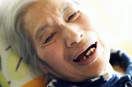 Close-up of smiling senior woman lying in nursing bed