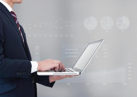 Businessman laptop and graph image