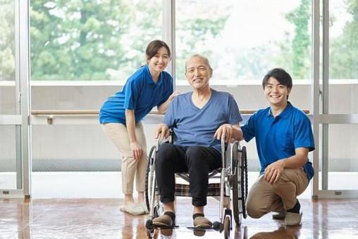 Elderly and male and female caregivers