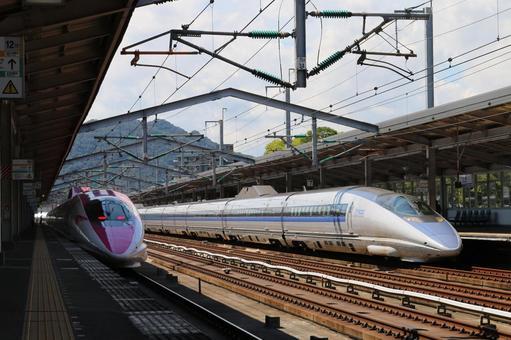 Pink and blue 500 series Shinkansen
