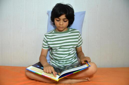 A Spanish boy who sits and reads books 3