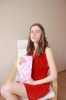 A woman sitting with a paper bag 2