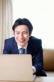 Hotel man using a laptop 6