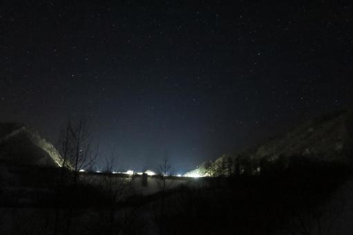Winter dam and starry sky