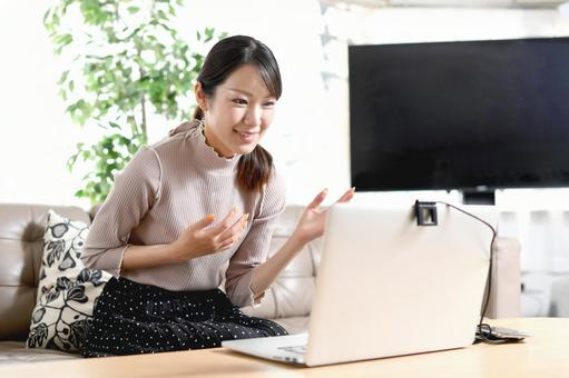 Laptop and smiling young woman