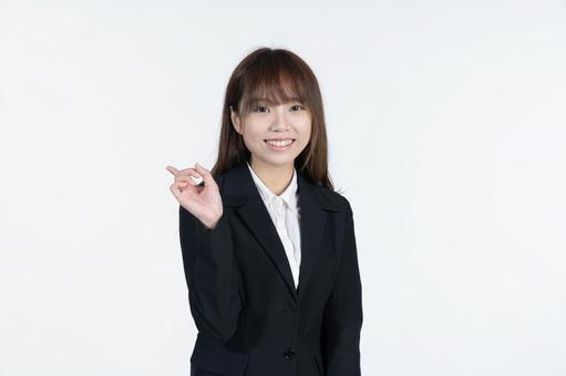 Chinese woman raising index finger white background