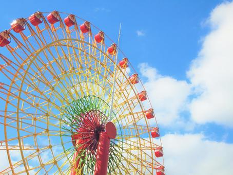 Blue sky and clouds and Ferris wheel