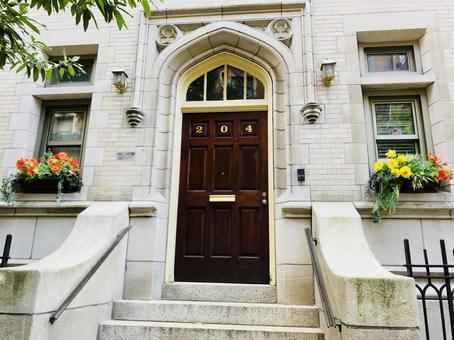 Manhattan apartment doors and flowers