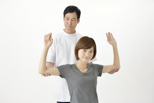 A gangster pulling a woman's arms behind