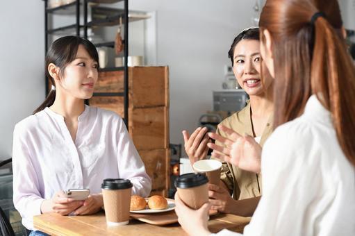 Image of multiple women talking indoors