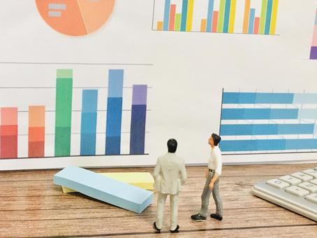 Business scene (two people discussing by looking at the graph)