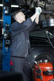 Automobile mechanic 7 working under the car 7