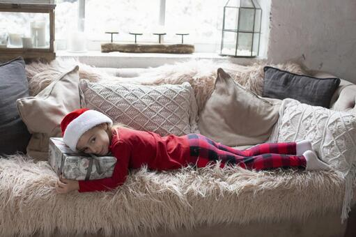 Child lying on the couch