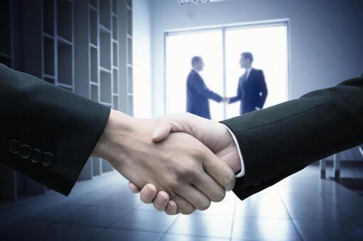Handshake of men in suit