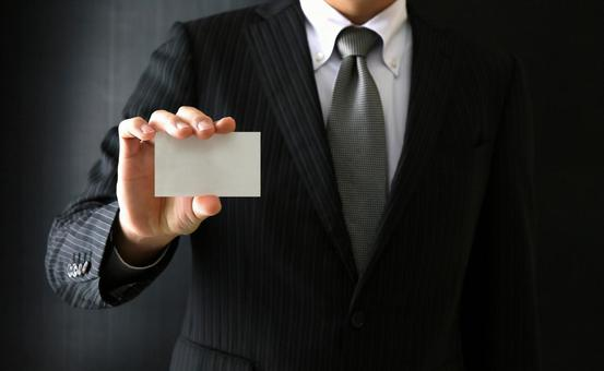 Businessmen with business cards