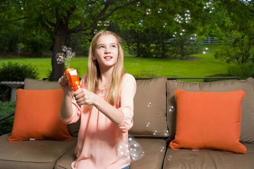 A girl playing with soap bubbles 4