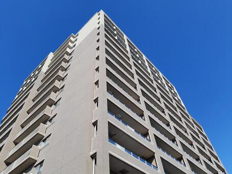 Looking up at a high-rise apartment (diagonal)