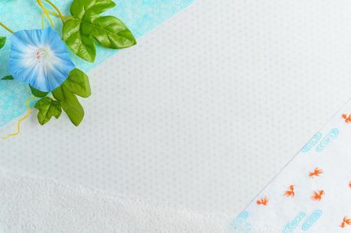 Summer background of morning glory and goldfish