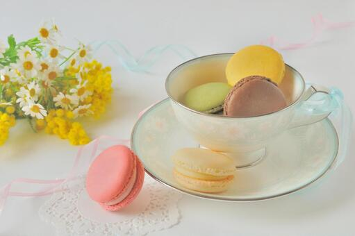Macaroons in tea cup