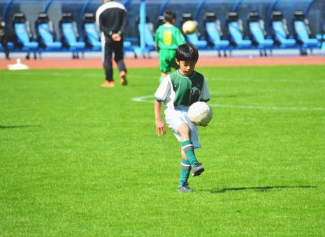 Lifting boy (soccer)