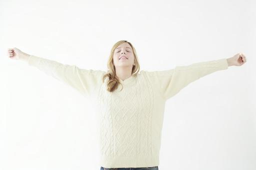 A woman taking a deep breath