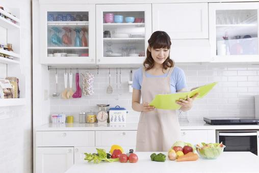 Women who watch recipes in the kitchen 1