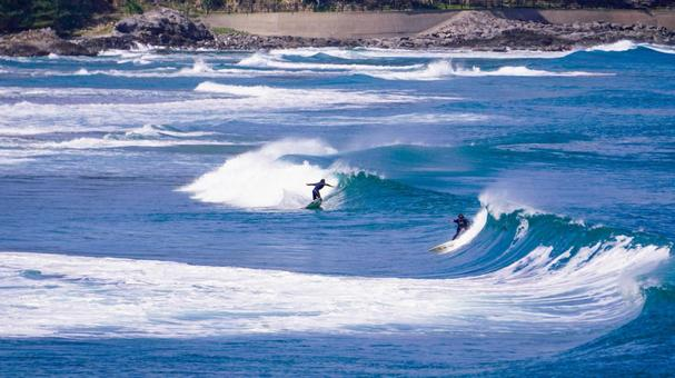 Surfing in the rough seas of the Sea of Japan