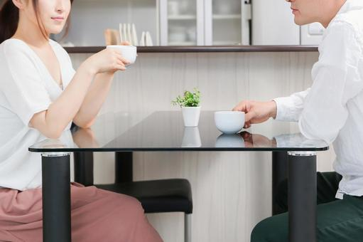 Men and women having a conversation over coffee