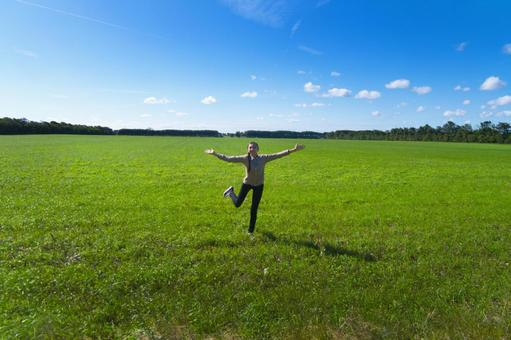 Dancing under the Nordic meadows and blue sky