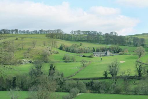 Beautiful English countryside and landscape with hills, houses and farms