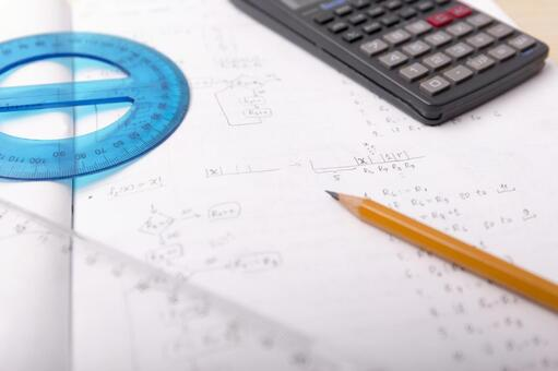 Pencil and protractor, triangle ruler, notebook and calculator
