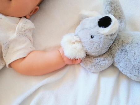 Baby holding a koala stuffed animal