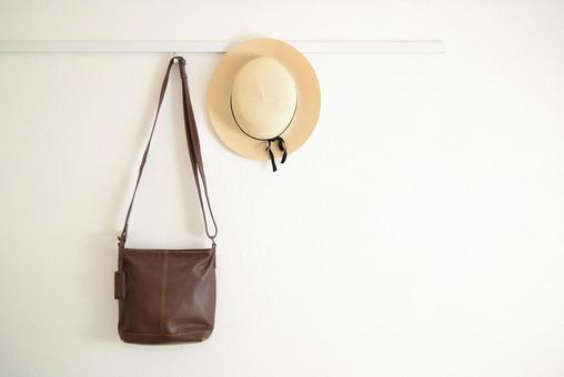 Wall bag and straw hat