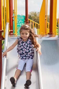Children sliding on a slide