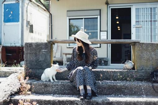 Woman and cat in straw hat