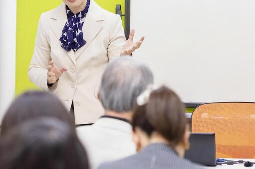 Woman talking at a seminar